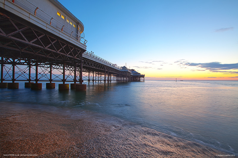 The tide was coming in fast but I really wanted to get the pier from this angle. There was no alternative but to get my feet wet!   Still it was worth it - just love how the wood pier seems to frame the sunset photo.   Main picture frames site: www.eframe.co.uk